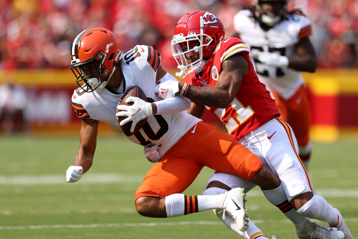 Anthony Schwartz #10 of the Cleveland Browns is tackled by Mike Hughes #21 of the Kansas City Chiefs at Arrowhead Stadium on September 12, 2021 in Kansas City, Missouri.