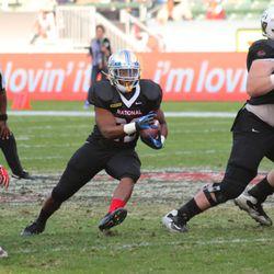 Trey Watts runs through a hole.