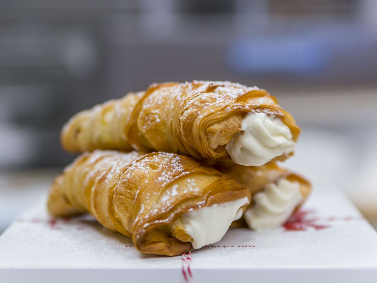 """<span data-author=""""-1"""">Cream-filled pastries on a white plate.</span>"""