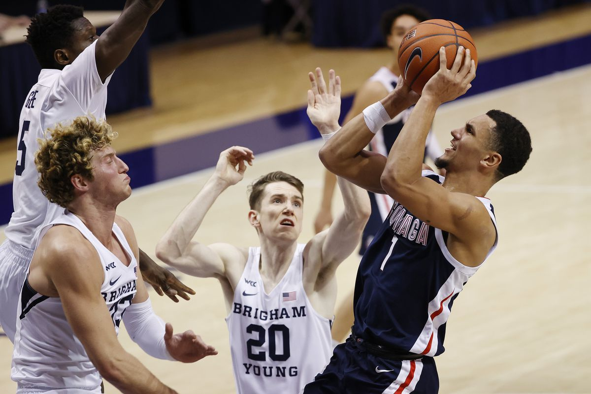Gonzaga Bulldogs guard Jalen Suggs looks to shoot against Brigham Young Cougars forward Caleb Lohner, left, and guard Spencer Johnson in the second half at Marriott Center.