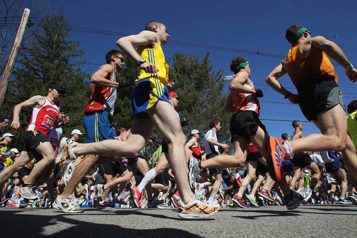 HOPKINTON, MA - APRIL 18:  Runners head out during the start of the 115th Boston Marathon on April 18, 2011 in Hopkinton, Massachusetts.  (Photo by Elsa/Getty Images)