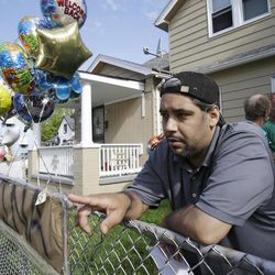 Ricardo DeJesus talks about his sister Gina at the family home Tuesday, May 7, 2013, in Cleveland. Police said Gina DeJesus and two other women who went missing separately about a decade ago were found in a house near downtown Cleveland Monday and likely had been tied up during years of captivity. Three brothers have been arrested.