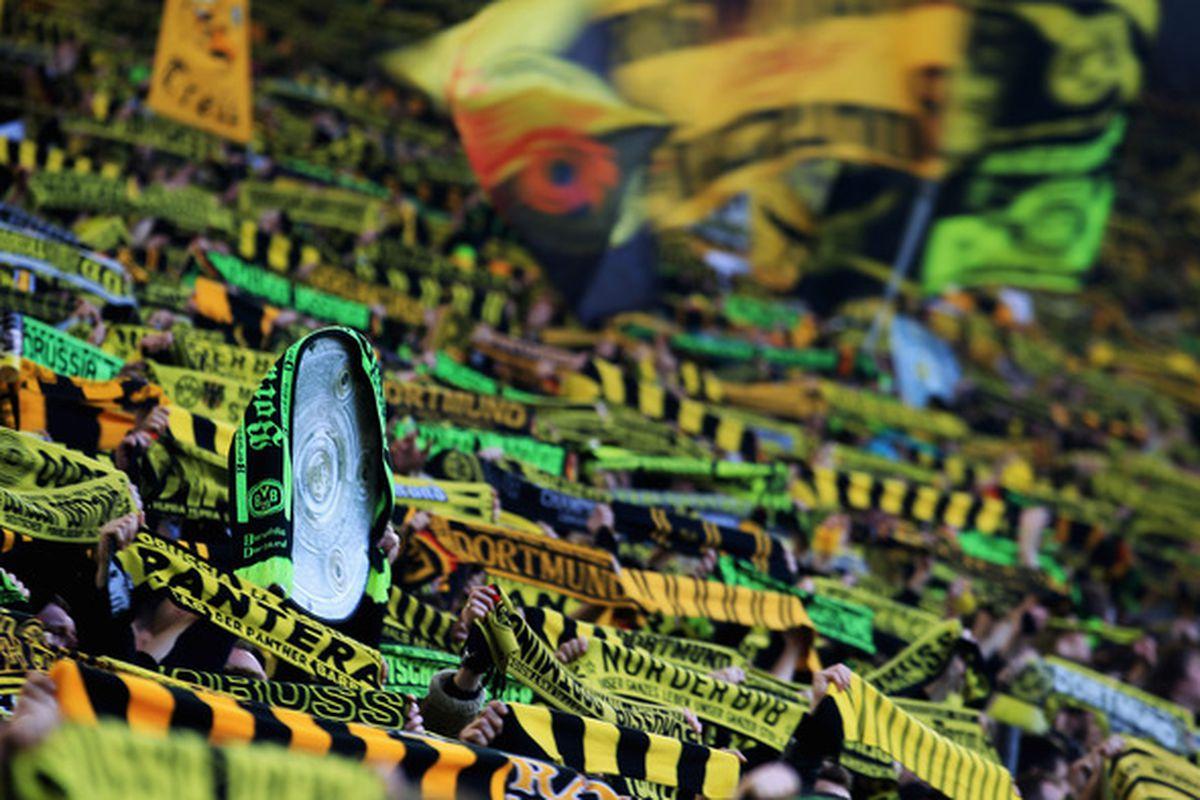 DORTMUND, GERMANY - MARCH 19:  Fans of Dortmund are celebrating prior to the Bundesliga match between Borussia Dortmund and FSV Mainz 05 at Signal Iduna Park on March 19, 2011 in Dortmund, Germany.  (Photo by Joern Pollex/Bongarts/Getty Images)