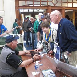 """Fans line up to have their copies of Billy Casper's autobiography, """"The Big Three and Me"""" signed by the legendary golfer in the Notre Dame bookstore."""