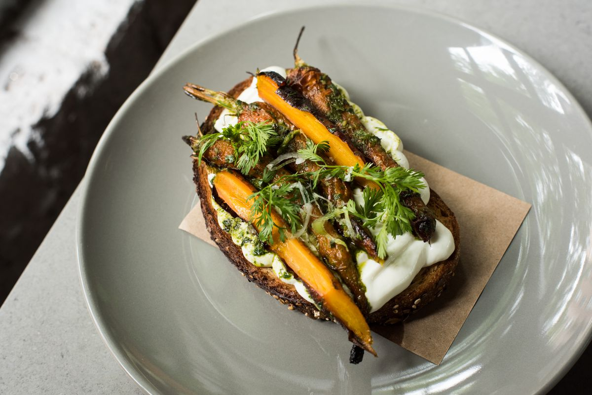 East One Coffee Roasters's carrot toast has several full pieces of carrot on top of a brown toast.