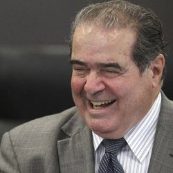 Supreme Court Justice Antonin Scalia speaks during a ceremony naming a courtroom at The John Marshall Law School after former Supreme Court Justice Arthur J. Goldberg Friday, Sept. 28, 2012  in Chicago.