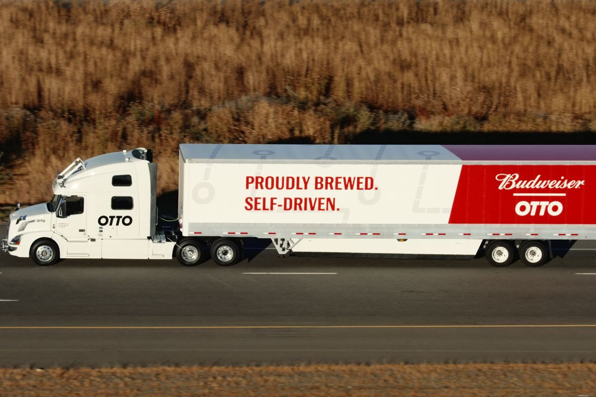 """An 18-wheel truck driving down a highway reads, """"Otto"""" and """"Proudly brewed. Proudly self-driven."""""""