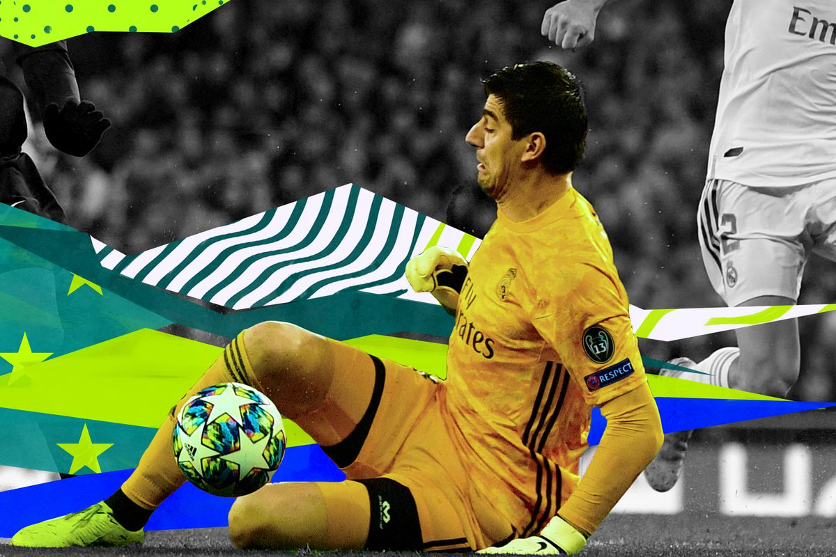 Photo of Real Madrid goalkeeper Thibaut Courtois on the ground as he fails to stop the ball from going in the net.