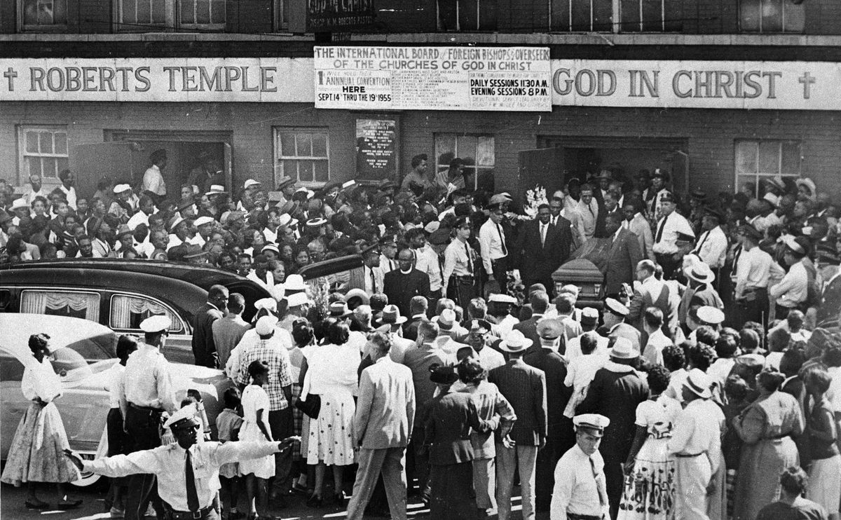 Pallbearers carry the casket of Emmett Till through a crowd gathered outside Roberts Temple Church of God in Christ on Sept. 6, 1955.