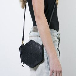 """Metalepsis Projects Condesa Wristlet, <a href=""""http://covetandlou.com/collections/tina-s-favorites/products/metalepsis-projects-condesa-wristlet"""">$167</a>"""