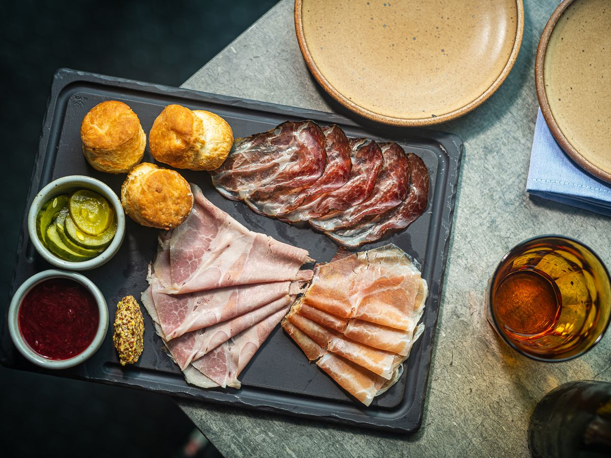 """A charcuterie """"salthouse board"""" at No Goodbyes comes with black pepper biscuits, homemade pickles, and jam"""