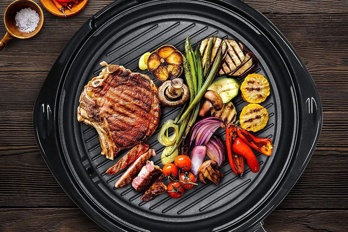 Assorted vegetables on a round grilling surface