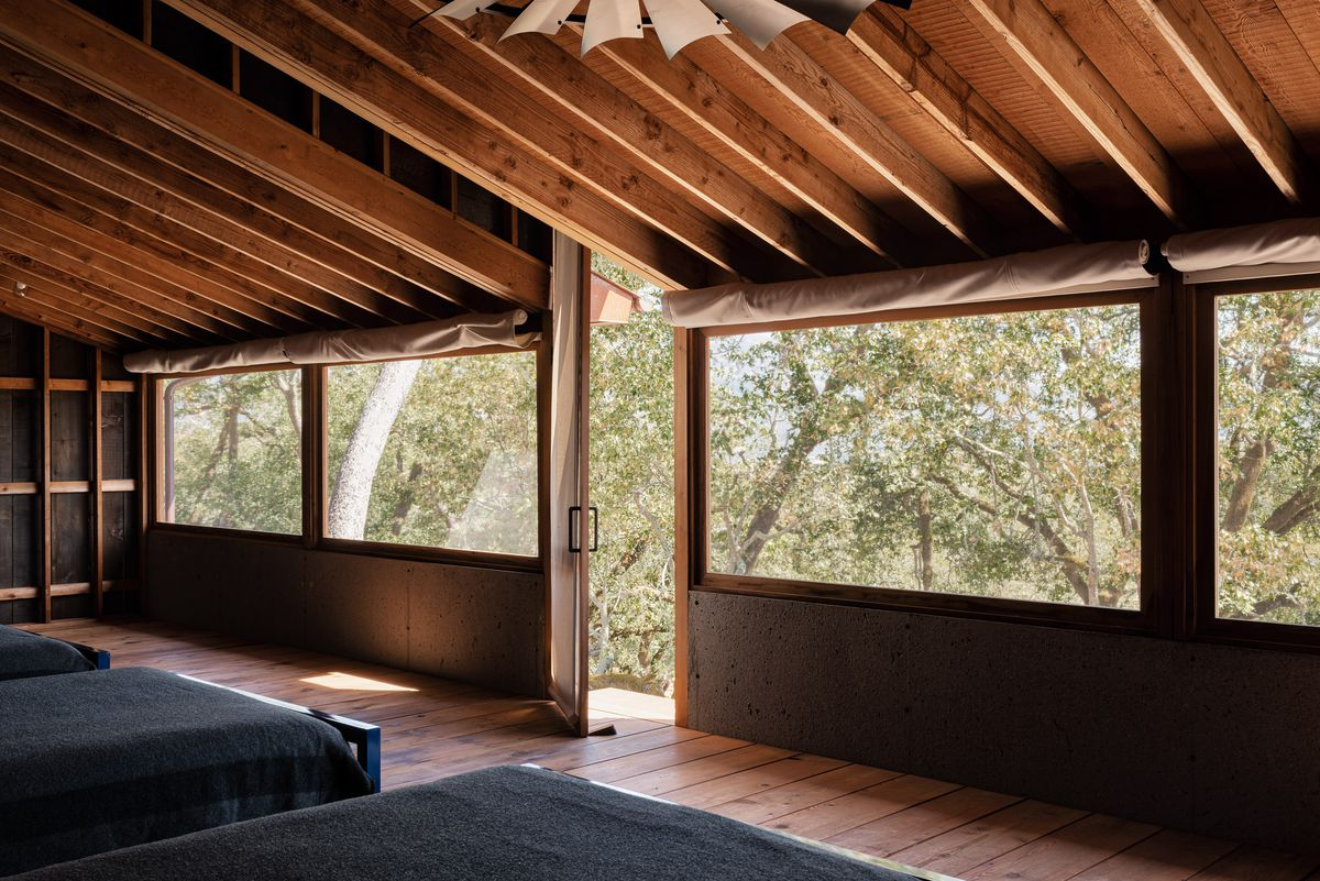 Beds inside screened-in porch.