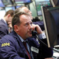 Broker Paul A. Mandile works the trading floor of the New York Stock Exchange short time  after the opening bell at the New York Stock Exchange up Thursday, Sept.. 6,  2012  (AP Photo/David Karp)