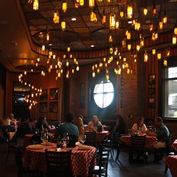 The dining room at Grimaldi's. Note the wine bottle light fixtures.