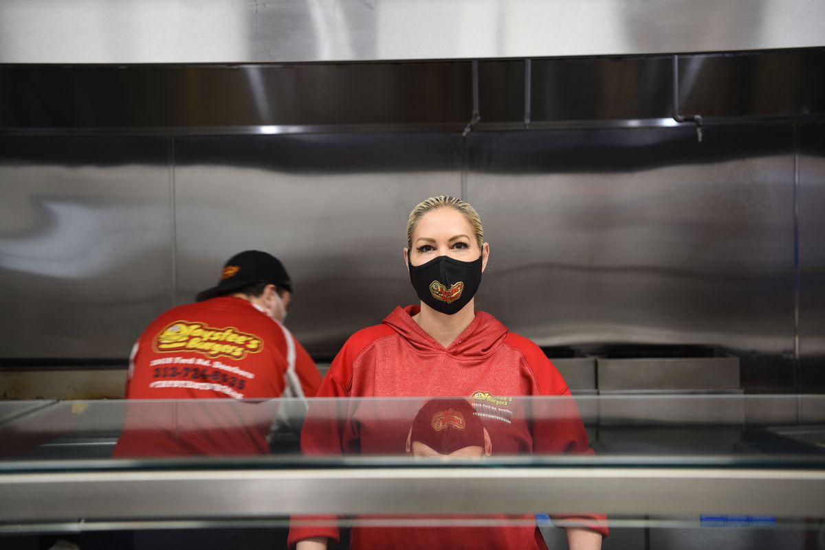 Lila, the mother of Taystee's Burgers owner Ali Jawad, stands behind the counter wearing a mask with her bleach blonde hair slicked back into a tight bun.