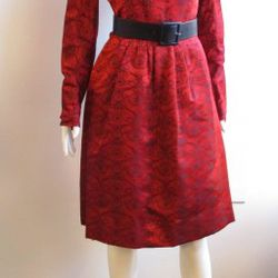 This charming red dress is made of 100% silk and is straight from the 1960s.  It has a unique black design and a zipper in the back.  Size medium, $25.00