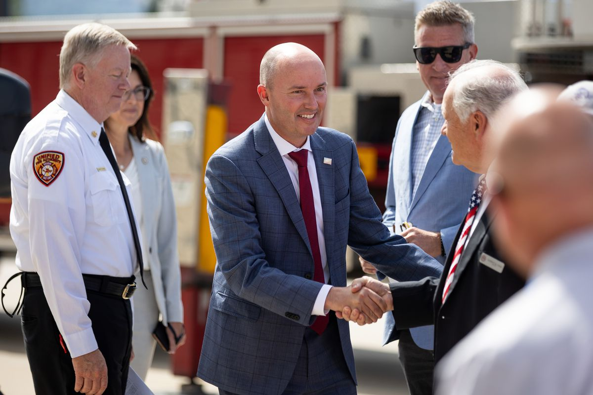 Gov. Spencer Cox greets Midvale Mayor Robert Hale before a press conference at the Capitol in Salt Lake City on Wednesday, June 30, 2021.