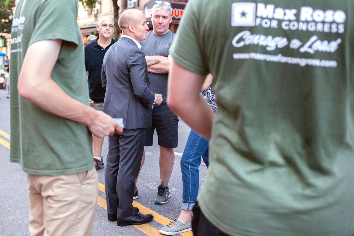 Max Rose campaigns in Bay Ridge, Brooklyn, in 2018.