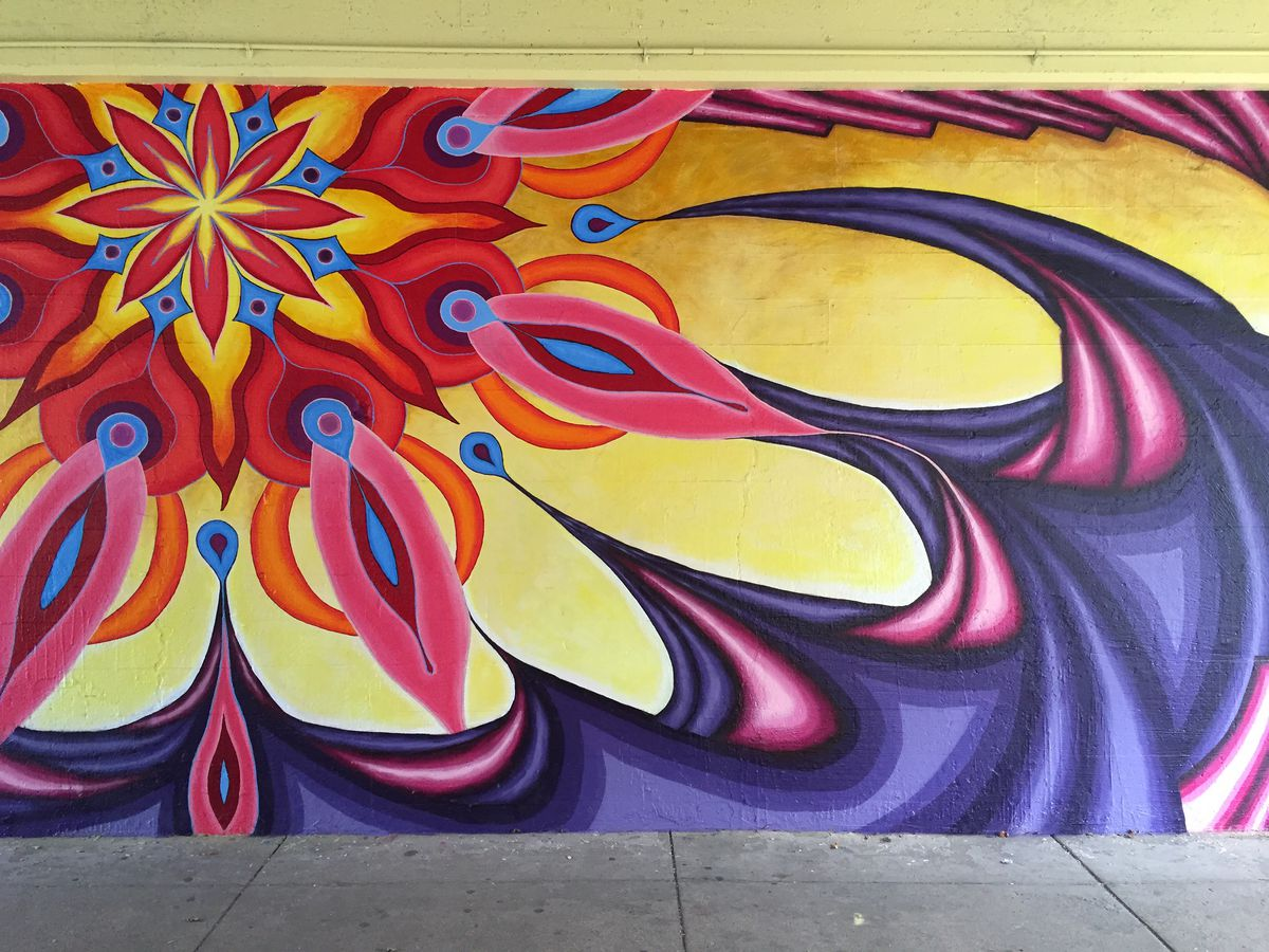 Many of the murals done by Lea Pinsky and Dustin Harris feature bright colors and geometric designs.