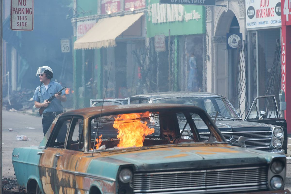A scene with a burning car from Detroit
