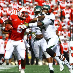 Running back Corey Clement stiff arms a defender