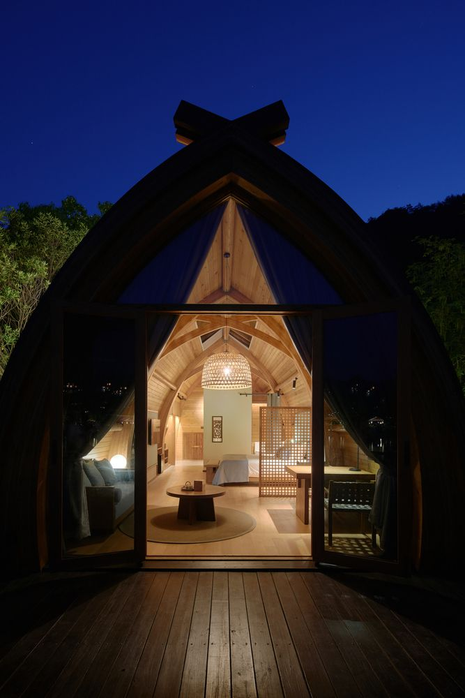 Exterior shot at night looking inside glowing cabin