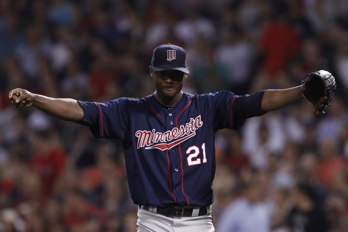 Aug 2, 2012; Boston, MA, USA; Minnesota Twins starting pitcher Samuel Deduno (21) reacts after the final out of the sixth inning against the Boston Red Sox at Fenway Park. Mandatory Credit: David Butler II-US PRESSWIRE