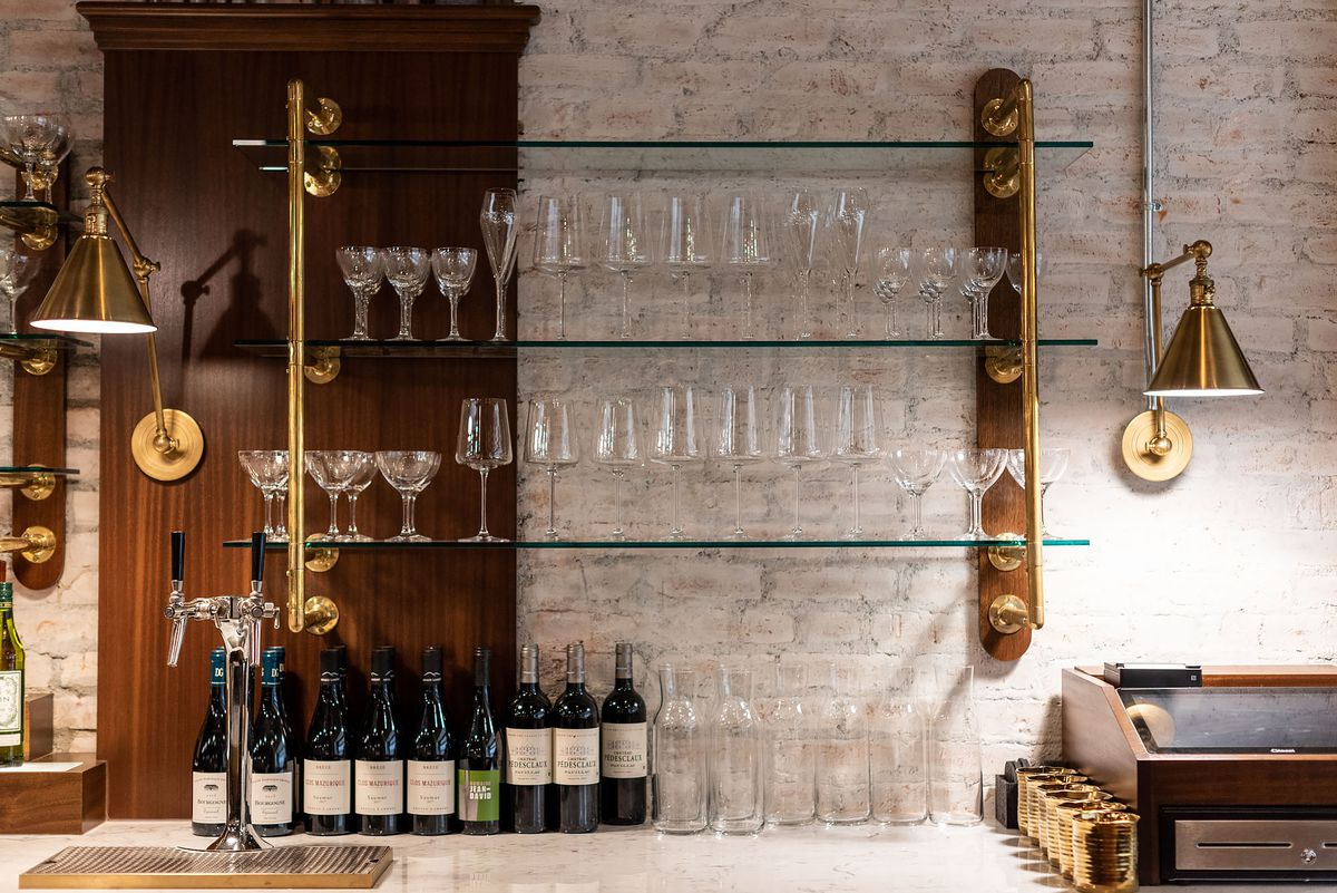 Bar details, including wine and cocktail glasses on a shelf.