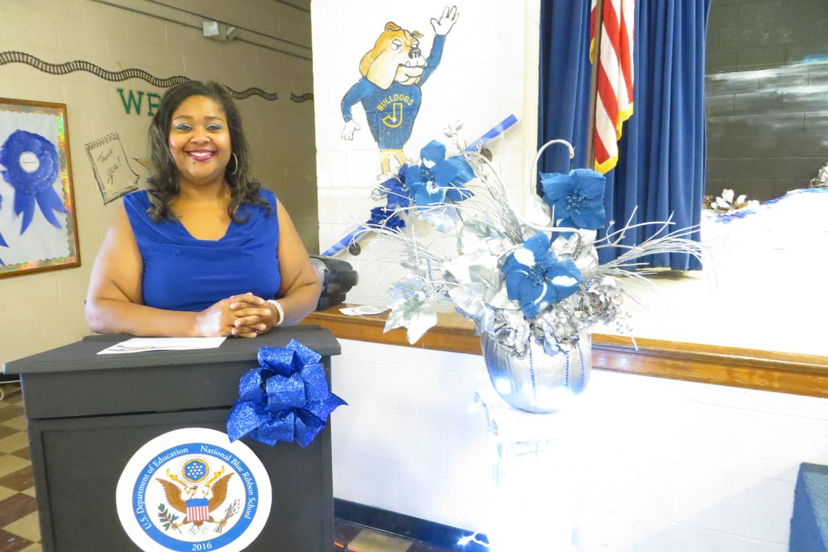 Principal Yolanda Heidelberg celebrates during a schoolwide event in November at Jackson Elementary, one of two Memphis schools honored as a 2016 National Blue Ribbon School.