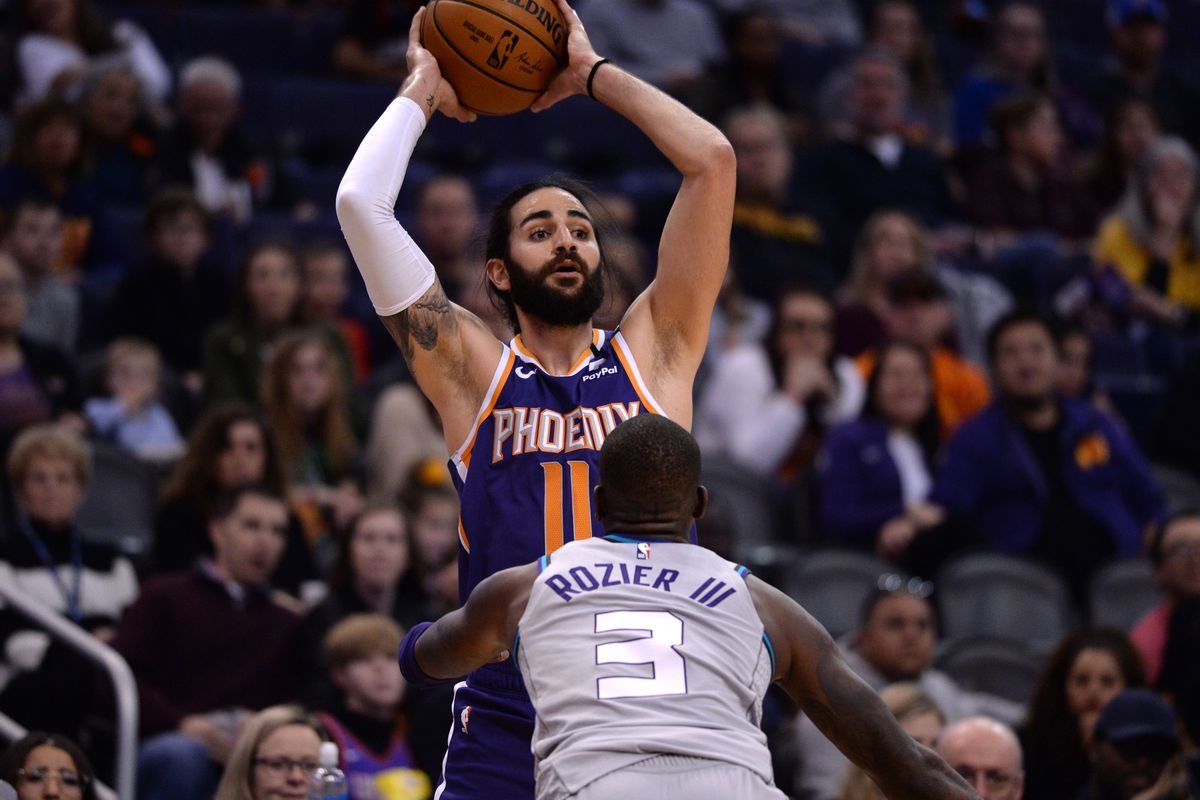 Charlotte Hornets guard Terry Rozier guards Phoenix Suns guard Ricky Rubio during the first half at Talking Stick Resort Arena.