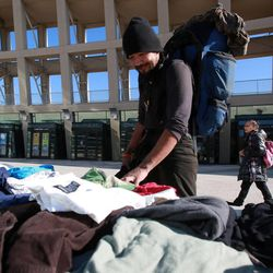 Elrich Damon looks through clothes at the Community Coat Exchange in the Salt Lake City Library Plaza in Salt Lake City on Friday, Nov. 29, 2013.