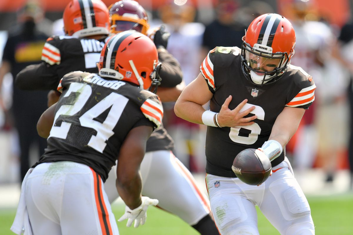 Quarterback Baker Mayfield hands off to running back Nick Chubb of the Cleveland Browns during the second half against the Washington Football Team at FirstEnergy Stadium on September 27, 2020 in Cleveland, Ohio. The Browns defeated the Washington Football Team 34-20.