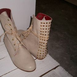 A pair of boots by Penelope and Coco