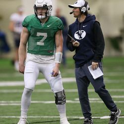Brigham Young Cougars quarterback Beau Hoge (7) gets the play from new quarterbacks coach Aaron Roderick during an intersquad scrimmage in Provo on Friday, March 23, 2018.