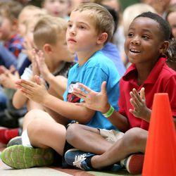 Bridger Haas and Jaisen Tetteh applaud as Utah Jazz center Rudy Gobert visits with students at Foxboro Elementary School in North Salt Lake, on Wednesday, Sept. 20, 2017.