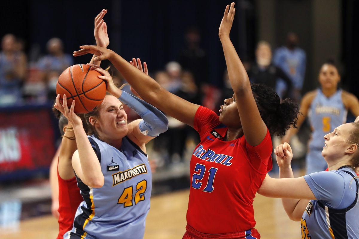 Marquette forward Lauren Van Kleunen (42) drives to the basket past DePaul's Darrione Rogers (21) during the first half of Wednesday's game.