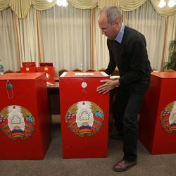 Election commission official sets ballot boxes at a polling station on the day before elections in Minsk, Belarus, Saturday, Sept. 22, 2012.  Belarus will hold a parliamentary elections on Sunday, but most power will remain in the hands of authoritarian President Alexander Lukashenko.