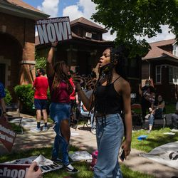 Youth activists stage a teach in outside Chicago Board of Education President Miguel del Valle's home in Belmont Cragin to demand an end to police presence in schools, Wednesday afternoon, June 24, 2020. The Chicago Board of Education is set to decide whether to end Chicago Public Schools' $33 million contract with the Chicago Police Department and pull out police officers from schools.