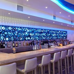 The mural behind the bar changes color to accommodate moods