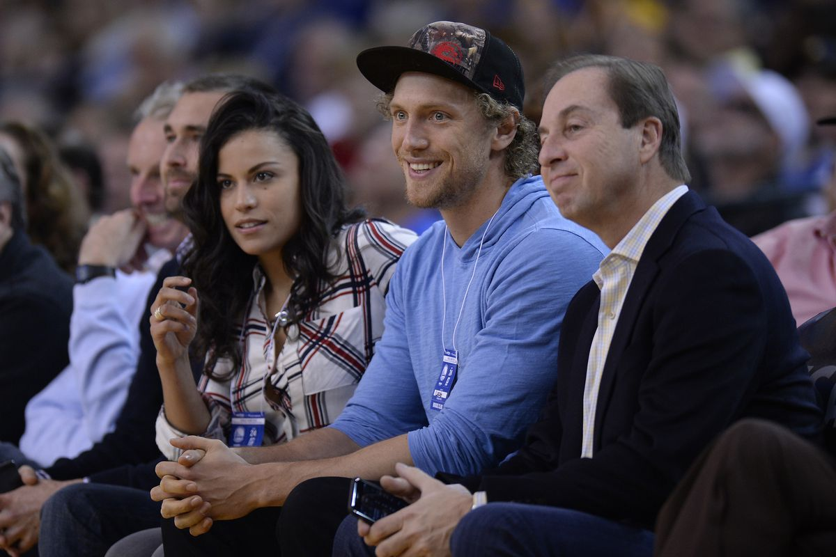 San Francisco Giants outfielder Hunter Pence sits with Golden State Warriors co-owner Joe Lacob in the first quarter of their game at Oracle Arena in Oakland, Calif., on Saturday, Jan. 31, 2015. (Jose Carlos Fajardo/Bay Area News Group)