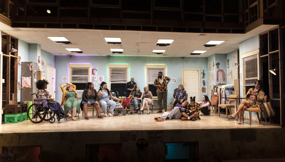 A room full of residents of a halfway house in the opening scene of the play Halfway Bitches Go Straight to Heaven.