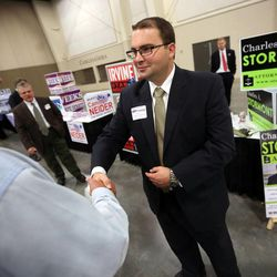 Warren Broadhead, left, shakes hands with Charles Stormont, Democratic candidate for Utah attorney general, at the Utah Education Association Convention and Education Exposition at the South Towne Expo Center in Sandy on Thursday, Oct. 16, 2014.