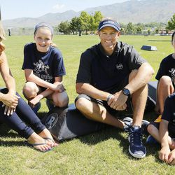 Utah State University football coach Matt Wells poses with his wife Jen and children Jadyn, Ella and Wyatt during a break in a kids football camp in Logan Friday, June 12, 2015.