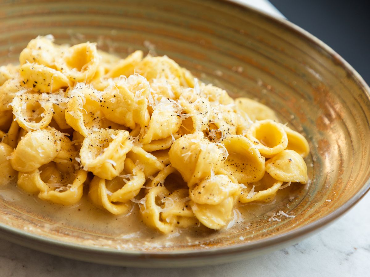 A plate of pasta with cheese.