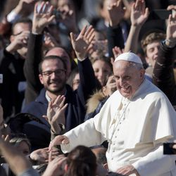 Pope Francis greets the crowd as he leaves  St. Peter's Square at the Vatican, Friday, Feb. 14, 2014.