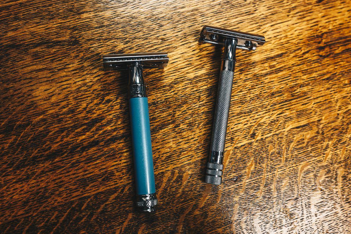 Two safety razors on wood