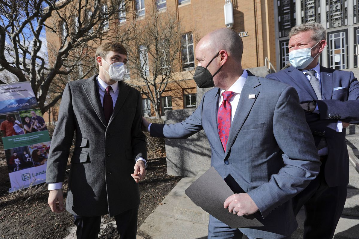 Ian Magruder, Landed's director of partnerships, left, and Gov. Spencer Cox chat after a press conference announcing the launch of Landed, a down payment assistance program that helps educators and government workers buy a home, outside of Ogden City Hall in Ogden on Tuesday, Feb. 23, 2021.