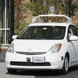California Gov. Edmund G Brown Jr., front left, rides in a driverless car  to a bill signing at Google headquarters in Mountain View, Calif., Tuesday, Sept. 25, 2012.  The legislation will open the way for driverless cars in the state. Google, which has been developing autonomous car technology and lobbying for the legislation has a fleet of driverless cars that has logged more than 300,000 miles (482,780 kilometers) of self-driving on California roads.
