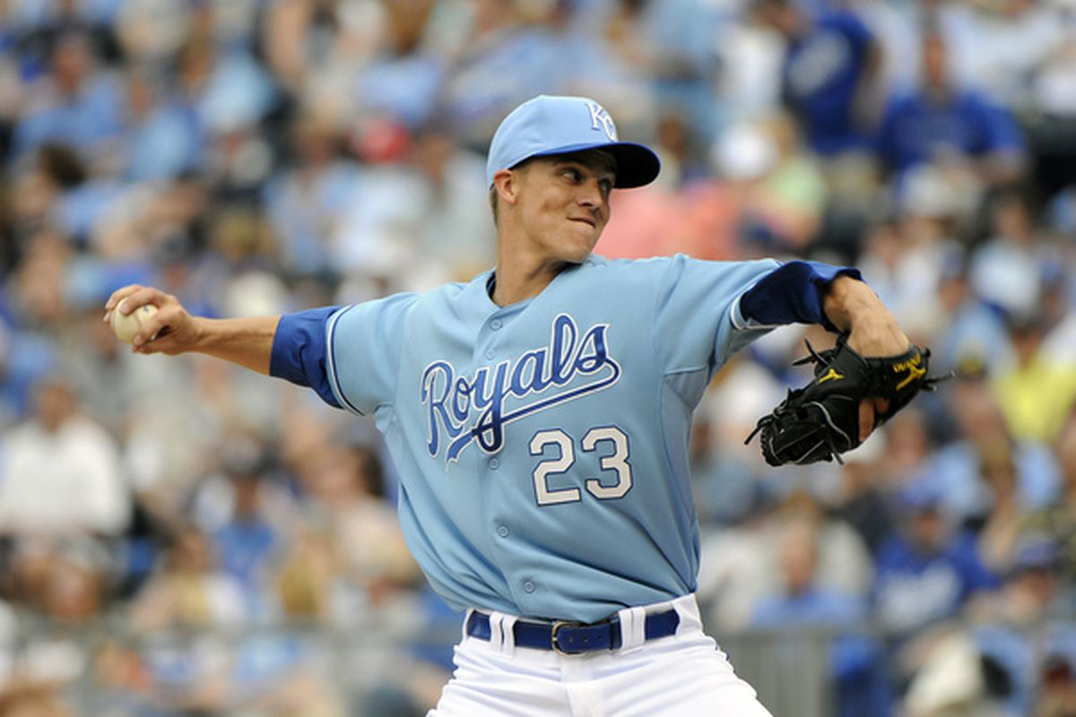 Zack Greinke joins the exodus of elite pitchers from the AL to NL. (Photo by G. Newman Lowrance/Getty Images)